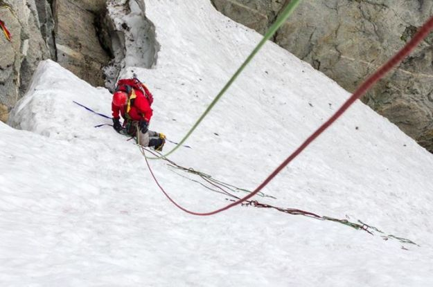 Steve making a snow bollard rappel anchor.