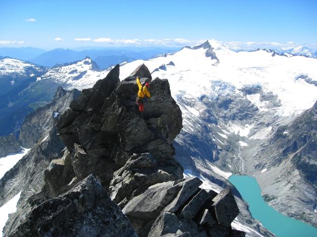 Matt descending the final gendarme near the summit of Forbidden Peak.